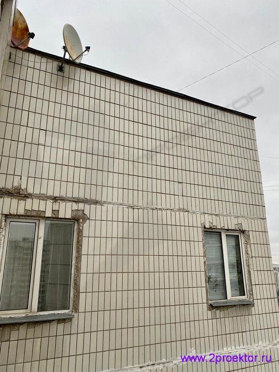 Фрагмент фасада с устройством двух окон.